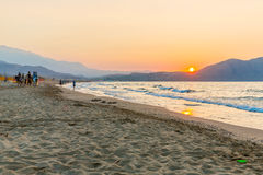 Beach on sunset in village Kavros in Crete  island, Greece. Magical turquoise waters, lagoons. Travel Background Royalty Free Stock Photo