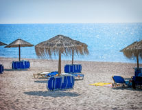 Beach with sunumbrellas and sunbeds Royalty Free Stock Photo