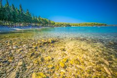 Beach in Supetar town on Brac island with turquoise clear water, Supetar, Brac, Croatia, Europe.  royalty free stock images