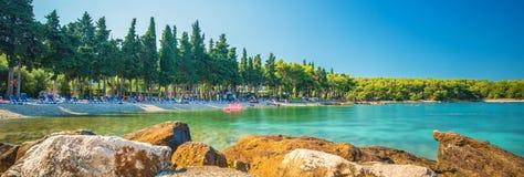 Beach in Supetar town on Brac island with turquoise clear water, Supetar, Brac, Croatia, Europe.  stock photo