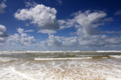 Beach, surf and cloudscape Royalty Free Stock Image
