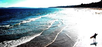 Beach surfer. Coast summer sea Royalty Free Stock Photography