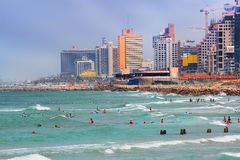 Beach and surfers in Tel Aviv, Israel Royalty Free Stock Image