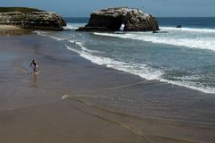 Beach Surfin. NaturalBridges, California stock photography
