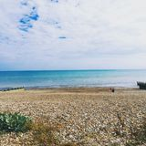 Beach Sussex. Shingle beach blue sky and sea royalty free stock images