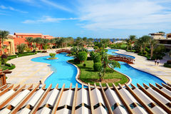 The beach with swimming pool at luxury hotel Stock Photo