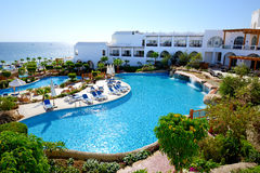 The beach with swimming pools at luxury hotel Royalty Free Stock Photos