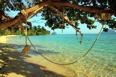 Beach swing. Rope swing on a beautiful Koh Kradan island, Thailand Royalty Free Stock Image