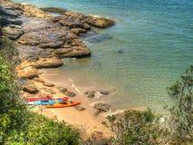 A beach in Sydney, Australia. Three kayaks on a beach in Sydney, Australia Royalty Free Stock Photo