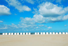 Beach symmetry. Row of beach cabins in Oostduinkerke,Belgium Stock Photo