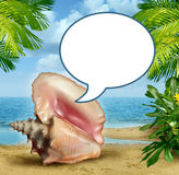 Beach Talk. Message and travel tips or vacation guide with an ocean conch shell communicating with a blank word bubble on a sandy tropical scene with palm trees Royalty Free Stock Photos