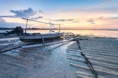 Beach of Tanjong Benoa Bali, Indonesia. Holiday in Bali, Indonesia - Reflection sunrise in Tanjong Benoa with boat Stock Photo