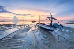 Beach of Tanjong Benoa Bali, Indonesia. Holiday in Bali, Indonesia - Reflection sunrise in Tanjong Benoa with boat Royalty Free Stock Photo