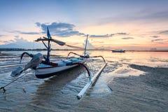 Beach of Tanjong Benoa Bali, Indonesia. Holiday in Bali, Indonesia - Reflection sunrise in Tanjong Benoa with boat Stock Image
