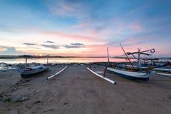 Beach of Tanjong Benoa Bali, Indonesia. Holiday in Bali, Indonesia - Reflection sunrise in Tanjong Benoa with boat Stock Photos