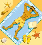 Beach tanning. Young man is enjoying tanning at the beach Royalty Free Stock Image