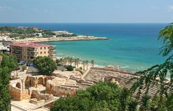 A beach in Tarragona, Spain. Aerial view of a beach in Tarragona in Spain with ruins of roman amphitheater Royalty Free Stock Image