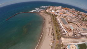Beach in Tenerife island - Canary. Aerial view of the picturesque beach and hotels stock video