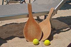 Beach tennis. Two rackets and two balls for the beach tennis Royalty Free Stock Photos