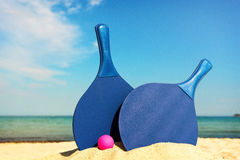 Beach tennis equipment on the beach Royalty Free Stock Photos
