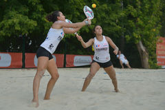 Beach Tennis World Team Championship 2014. Moscow, Russia - July 18, 2014: Marie-Eve (left) and Mathilde Hoarau of France in the match against Italy during ITF Royalty Free Stock Image