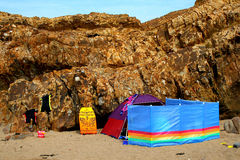 Beach tent with colourful windbreaker and wetsuits Royalty Free Stock Photo