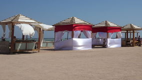 Beach tent swaying on the wind stock video footage