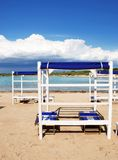 Beach tents and sunbeds Royalty Free Stock Photo
