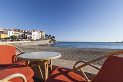Beach and terrace bar view of maritime french village of Banyuls-sur-mer,Cote Vermeille,Occitanie,France. Royalty Free Stock Images