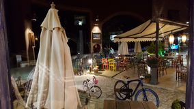 Beach terrace at night. A summer night on an empty beach terrace with bicycle and Stock Photography
