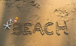 Beach Text on Sand Beach royalty free stock image