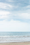 A beach in Thailand with cloudy sky. Background. Cloudy day. Sea and sand in HuaHin, Thailand Stock Image