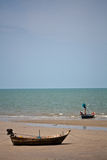 Beach of thailland. There are beaches in southern Thailand. In this photograph of a fishing boat with fishermen on the beach Royalty Free Stock Photo