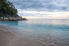 Beach in Thasos, Greece. Saliara Marble beach on Thasos Island, Greece by sunset Royalty Free Stock Photography