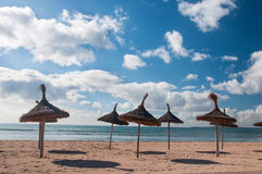 Beach with thatched umbrellas Royalty Free Stock Photo