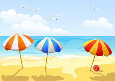 Beach and three sun umbrellas Royalty Free Stock Photography