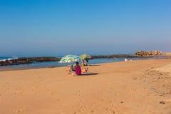 Beach Tidal Pools Public Umbrellas stock photo