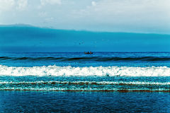 Beach, tide, wave and the blue ocean Stock Photography