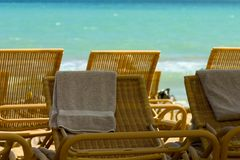 Beach time. Beach chairs with towels on the sand Royalty Free Stock Image