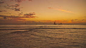 Beach Time Lapse Post Sunset. V30. Beautiful wide angle beach time lapse clip of surfers and boats right after sunset stock video footage