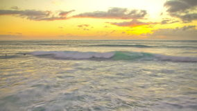 Beach Time Lapse Sunset Surfers. V18. Beautiful time lapse clip of waves and surfers during sunset stock video footage
