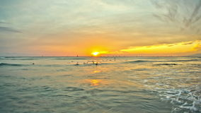 Beach Time Lapse Sunset Surfers. V24. Beautiful time lapse clip of waves and surfers during sunset stock video