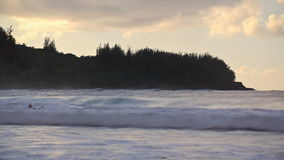 Beach Time Lapse Surfers. V4. Beach time lapse clip of waves and surfers stock footage