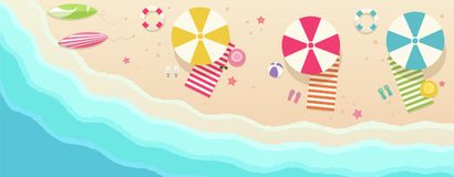Beach, top view with umbrellas, towels, surfboards Stock Image