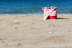 Beach tote on a sandy beach out of focus Royalty Free Stock Image