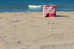 Beach tote on a sandy beach. In summer Stock Photos