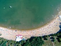 Beach with tourists. Aerial view on the beach with tourists Royalty Free Stock Images