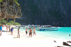 Beach with tourists and motor boats Stock Photo
