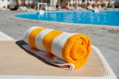 Beach towel on the bright sun lounger Stock Photos