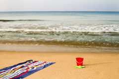 Beach and towel. Towel on the beach and cube Royalty Free Stock Images